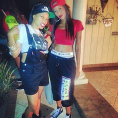 To dress as hip-hop stars Aaliyah (who sadly passed away in 2001) and Mary J. Blige, you'll need crop tops, workout pants, some bling, and denim, '90s style. Then load up on the attitude and work it, girl.