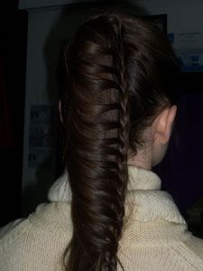 The FULL article gives the how-to on creating this awesome draped french braid.