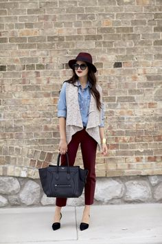 Loft cable knit vest & Marisa ankle pants J.Crew Keeper chambray shirt Vince Claire pumps Celine bag (similar) Trina Turk hat (similar) Prada cat's eye sunglasses Fall Outfits For Work, Cool Outfits, Outfits Otoño, Koi, Burgundy Pants, Maroon Pants, Deep Burgundy, Pink Pants, Blue Jeans