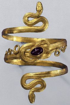 Gold snake bracelet with garnet, from the Greek-Hellenistic period, 3rd-to-2nd century BC. http://www.annabelchaffer.com/categories/Gentlemen/