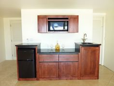 kitchenette | Built-in, cherry wood kitchenette with granite counters