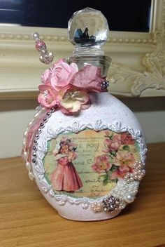 Altered bottle in shabby chic style using rice paper image, lace, ribbon and flowers from Recycled Glass Bottles, Glass Bottle Crafts, Wine Bottle Art, Diy Bottle, Estilo Shabby Chic, Shabby Chic Style, Lace Jars, Shabby Chic Vanity, Decoupage Glass