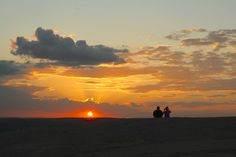 Catch a beautiful Texas sunset from the top of Enchanted Rock near Fredericksburg, Texas