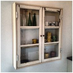 Our latest indoor project - a cupboard made of old windows from our house.