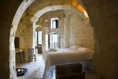 ::sharp inhale:: Albergo della Civita.  Matera, Italy. UNESCO world heritage listed. The hotel is spread over a number of Sassi or caves, simply furnished.