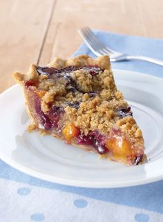 This peach blueberry pie is almost too pretty to eat. Almost. Cinnamon-laced butter and brown sugar crumble topping is a sweet bonus.