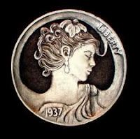 A carved nickel, also known as a hobo nickel. Soldiers at war often practiced the hobby of nickel carving, returning home with carved coin necklace pendants for their wives and girlfriends.