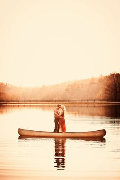 Couple standing in Canoe on calm lake embracing - Style Me Pretty | Gallery | Picture | #579093