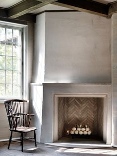 "We love the simplicity of this corner fireplace where it seems as if the ""Girl with a Pearl Earring"" just walked away. We love the simplicity of this corner fireplace where it seems as if the ""Girl with a Pearl Earring"" just walked away. Home Fireplace, Fireplace Surrounds, Fireplace Mantels, Fireplace Ideas, Mantles, Corner Fireplaces, Stone Fireplaces, Fireplace Inserts, Stone Fireplace Designs"
