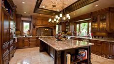 Traditional Kitchen with Kitchen island, electric cooktop, Undermount sink, double wall oven, Complex granite counters