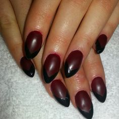 Matte red with a shiny black french shellac on stiletto nails.  Instagram @boop711