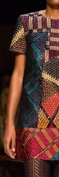 A patchwork jacquard dress in colourful, contrasting panels of metallic jacquard on the Burberry February 2016 runway