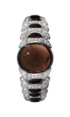 """Haute Jewelry: Cartier Collection l'Odyssée - Hautetime - White gold bracelet with one 88.73-carat cabochon-cut brown tourmaline, obsidian, brilliants."""