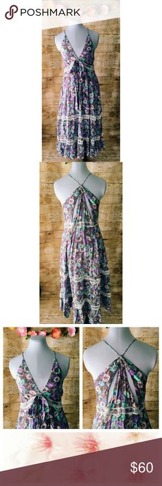 NWOT Gorgeous Olivaceous Floral Maxi Dress Beautiful maxi dress in summer floral print I purple & blue. Features cut out waist lace detail with tie belt in same fabric as dress. It also has two lace cut outs in the skirt. Dress has V neckline, spaghetti straps & sexy cut outs on back. This dress is a show stopper and brand new!!! Olivaceous Dresses