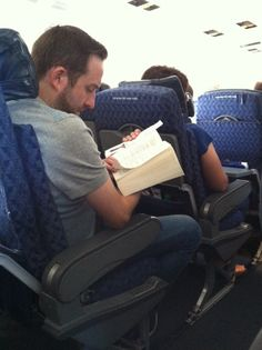 He's reading Game of Thrones, George R.R. Martin.