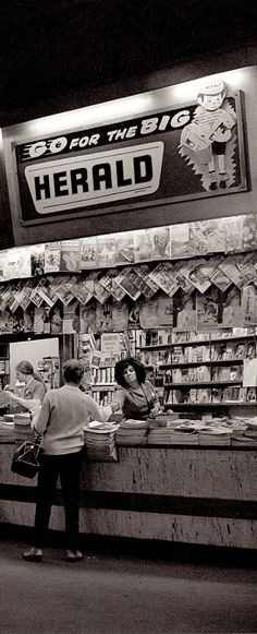 60's MELBOURNE NEWSSTAND Flinders Street Station Melbourne 1969. (EXTRA PHOTO DETAIL) I love the woman in the big hair selling papers, & cigarettes are openly displayed, you just don't see that anymore. And The Queen on the Women's Weekly cover & the Girlie mags all pinned up. Great photo. From the fabulous book MELBOURNE by Angus O'Callaghan by Ben Albrecht 2015. (minkshmink on pinterest)