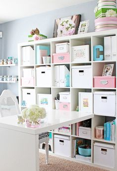 White shelving with pastel organizers