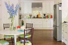 Colorful Upholstery - Eat-In Kitchens - Southernliving. This homeowner used bright upholstery on her dining chairs to accent a neutral kitchen.