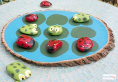 Learn how to make an adorable ladybugs vs. tadpoles outdoor tic tac toe game using rocks, a wooden plank and weather-resistant Patio Paint from DecoArt.