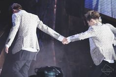 "Minseok: ""you can let go, you know."" Luhan: ""no way."""