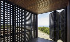The Moonlight Cabin, designed by Australian architecture firm Jackson Clements Burrows, can transform from a tightly shuttered fortress to an open-air living space in just a few moves.