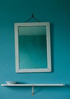 Teal bathroom mirror by fsmphoto via flickr