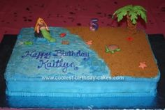 Homemade Beach Birthday Cake: This Beach Birthday Cake is a 12 x 18 double layer sheet cake. I used decorator icing for the inside, sides and water. I iced it all with the blue and