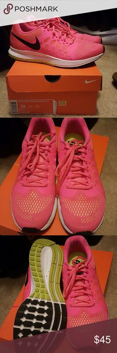 Nike Air zoom sneakers Pink with yellow . Wins Nike Air zoom Pegasus Worn mostly in side . Nike Shoes Athletic Shoes