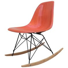 Eames Herman Miller Orange Rocker | From a unique collection of antique and modern chairs at https://www.1stdibs.com/furniture/seating/chairs/