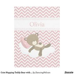 Cute Napping Teddy Bear with Custom Monogram Fleece Blanket - A cute little girl teddy bear naps on a cloud in this delightful nursery design. The background is a pink and white matching chevron ziz-zag pattern and a polka-dot trimmed band of white. Edit the name with your baby's name for a sweet fleece blanket to keep your little angle snuggly and warm. Sold at DancingPelican on Zazzle.
