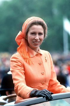 Anne attends the Great Children's Party In Hyde Park, London, in bright orange.