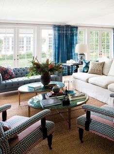 California Eclectic Gets a Traditional Twist// two coffee tables, tufted sofa, blue drapes