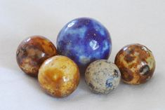 These marbles are called benningtons. They are handmade clay and were made in Germany about a century ago - I think they look like planets, I have these. Lava, Glass Bead Game, Glass Art, Glass Marbles, Glass Beads, Old Fashioned Toys, Marble Art, Glass Paperweights, Chalk Art