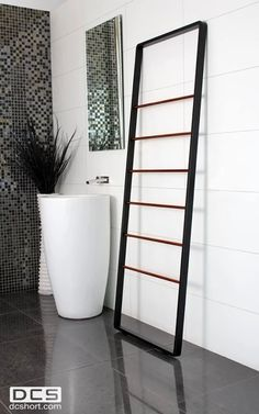 DCS Custom Heated Towel Ladders DCS custom heated towel ladders in hardwood timber for a more organic bathroom style or powder coated matte black for a more contemporary bathroom design.