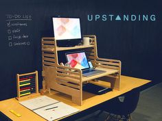 The UpStanding Desk by UpStanding — Kickstarter.  Turn any desk or table into a standing desk using the adjustable, portable, affordable UpStanding Desk. Think on your feet.