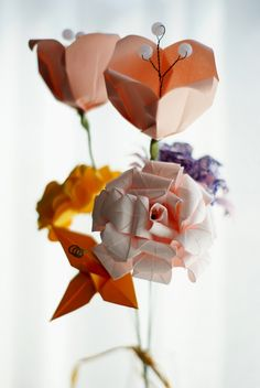 from a very nice website - in the tutorial section learn how to do those origami flowers