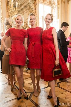 Matching ladies in red: Sophia Hesketh, Jacquetta Wheeler, and Lauren Santo Domingo, all in Dolce & Gabbana.