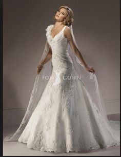 Lace drapery over white gown