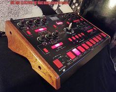 Red Sound Dark Star in Mahogany Music Sequencer, Electronic Music Instruments, Digital Dj, Recording Equipment, Drum Machine, Dark Star, Recording Studio, Custom Wood, Wood Crafts