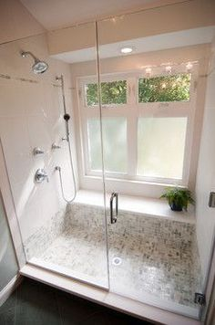 Bathroom Windows in he shower area, with bottom frosted window designs. A nice shelf by the window. It can also be used as a seating area while in the shower.