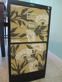 Wallpaper fronted filing cabinets. Tutorial at: http://californiacallahans.blogspot.com/2011/02/filing-cabinet-beautified.html
