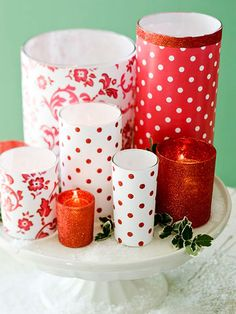 I am so in love with this center piece!  This could easily be put together with candle holders, and scrapbook paper already on hand.  It is so cheerful, and happy - perfect for the upcoming holidays.  (and at $0 it is perfect!) candl display, christma candl, holiday centerpieces, candle holders, holidays, scrapbook paper, christmas candles, the holiday, diy christmas