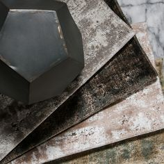 Distressed velvet with a marble grid pattern, S. Harris' Mesmerize mixes classic and modern into one pattern. Available in four color ways: Argent, Antique Bronze, Parchment and Patina. Fabricut Fabrics, Fabric Wallpaper, Fabric Decor, Grid, Branding Design, Marble, Bronze, Velvet, Textiles