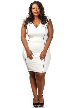 This hot sexy plus size dress features a contrast trim, v-neck and knee length fit. Soft, stretch material 50% Rayon 45% Polyester 5% Spandex Model wearing 3X made in USA