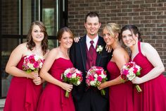 hot pink and deep raspberry coloured flowers are a great compliment to wine coloured bridesmaids dresses