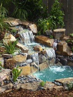 It's not difficult to create a waterfall pond feature rather than the conventional pond. With this small waterfall pond landscaping ideas you will inspired to make your own small waterfall on your home backyard. Waterfall Design, Garden Waterfall, Small Waterfall, Waterfall Fountain, Backyard Water Feature, Ponds Backyard, Backyard Waterfalls, Garden Ponds, Ponds With Waterfalls