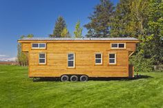 This is the Loft Edition extra large tiny house on wheels by Tiny Living Homes in Delta, British Columbia, Canada. It's built right onto a 28′ trailer frame with three 5,000lb axles on …