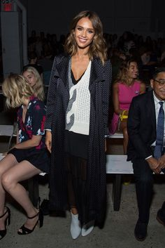 Jessica Alba wears a gray and white sweater, printed duster, midi skirt, and booties