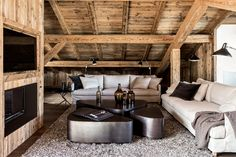 The interiors of this chalet in Mégève, France, makes a bold statement on earthy design and natural materials. Wooden Facade, Chalet Design, Gravity Home, Modern Rustic Homes, Natural Interior, Black Floor Lamp, Modern Room, Rustic Interiors, Grey Curtains