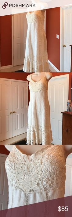 Sue Wong off white lace dress BEAUTIFUL!! This is a Sue Wong dress with gorgeous lace accents. This dress is lined, criss cross straps in the back with a side zipper. This is a 12 but I would say a small 12 more like a 10/12. Worn once for a wedding in Ochos Rios... been in the closet since (years) someone needs the love this piece!!! Sue Wong Dresses